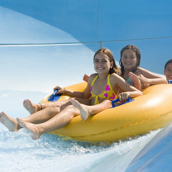 Take a wild ride with the whole family on a tube slide at a Florida water park by the beach.