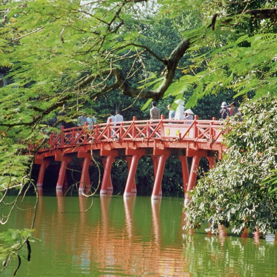 Wander through the park at Hoan Kiem Lake in the heart of Vietnam's ancient capital, Hanoi.