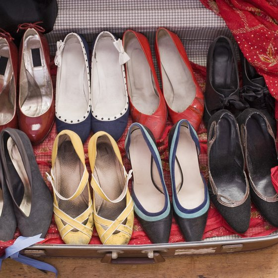 Fit small items like phone chargers and bags of jewelry in your shoes to conserve space.