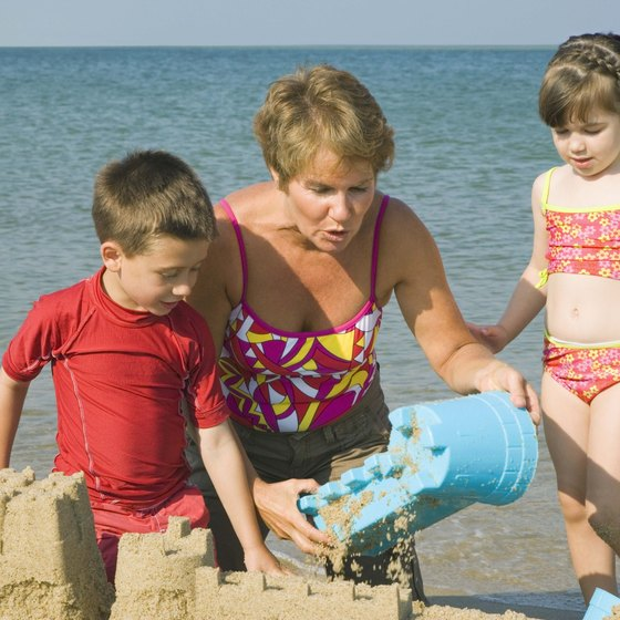 Children enjoy building sand castles.