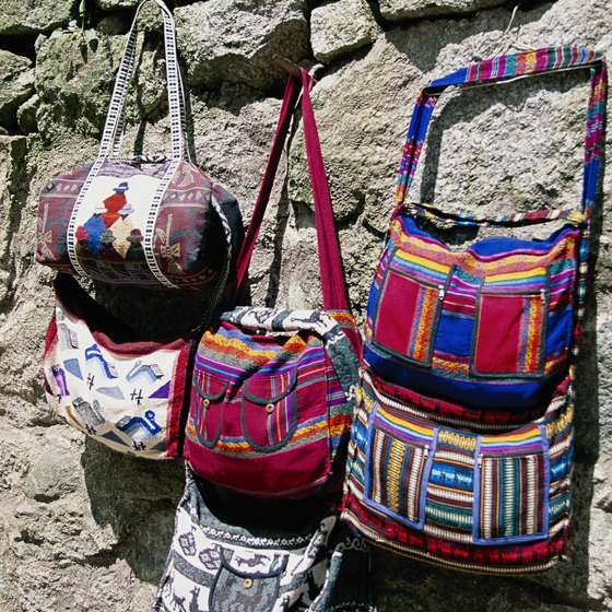 Peruvian traditional dress uses brightly colored fabrics, as evidenced in these handbags.