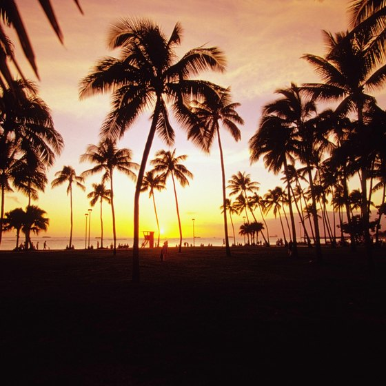A beach stroll at sunset is the perfect romantic Hawaiian honeymoon activity.