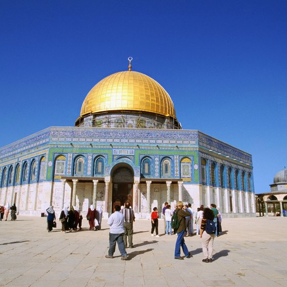 Cover up when visiting religious sites like the Dome of the Rock.