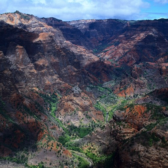 Rugged Waimea Canyon is known as the Grand Canyon of Hawaii.
