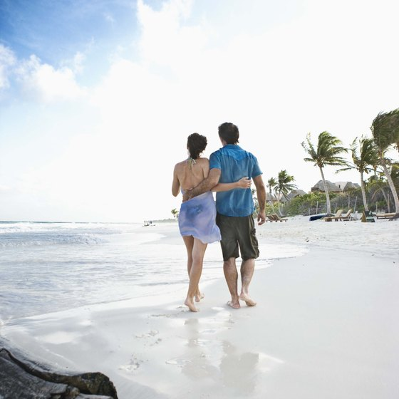 The white sand beaces of the Mayan Riviera are backed by tropical forest and lined with upscale resorts.