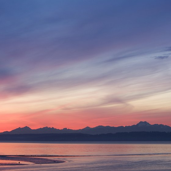 The sun sets over the Olympic Mountains, a backdrop to an RV camping adventure.
