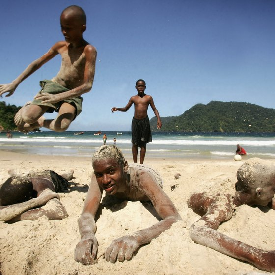 Local boys play on the beach at Maracas Bay in Trinidad.