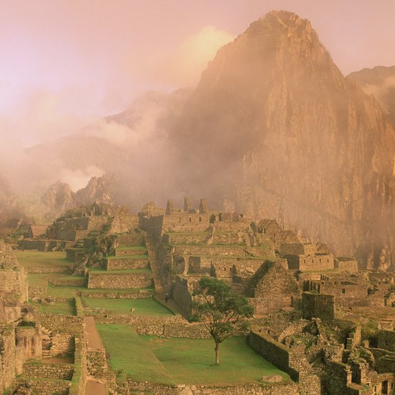 Your four-day hike ends with sunrise at the Machu Picchu ruins.