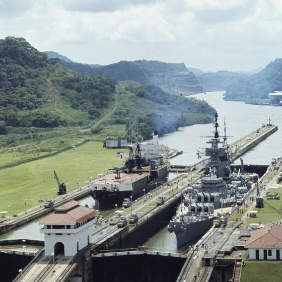 Ships pass between the Atlantic and Pacific Oceans at the Panama Canal.