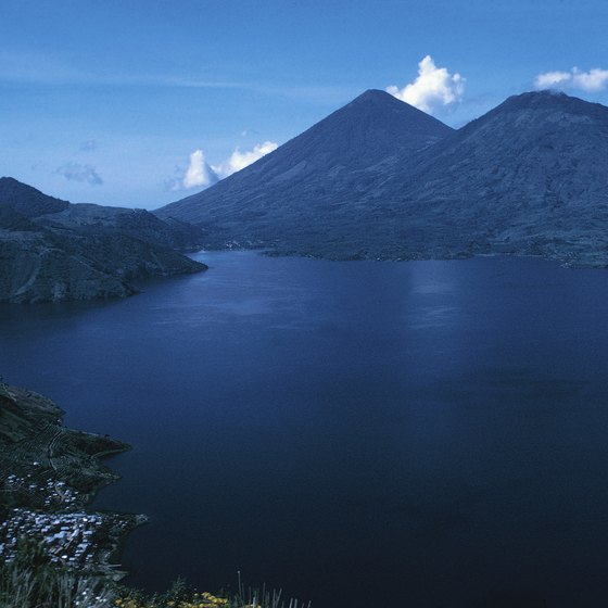 Small Mayan villages and three volcanoes ring Lake Atitlan.