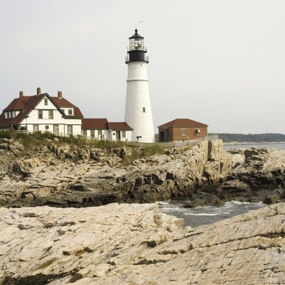 Lighthouses and rocky cliffs are iconic sights along the New England coast.