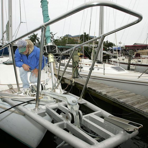 A boater checks his lines at a Naples dock