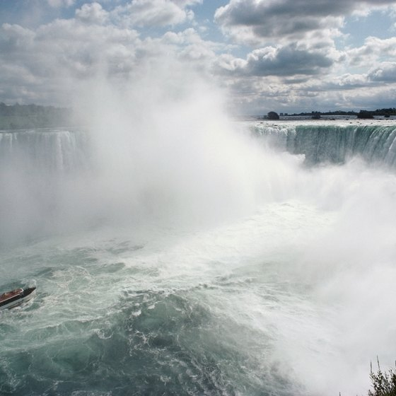 Vacationers on a Niagara Falls tour can ride the famous Maid of the Mist into the base of the falls.