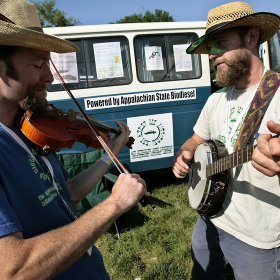 Appalachian State students make music next to their bio-diesel bus.