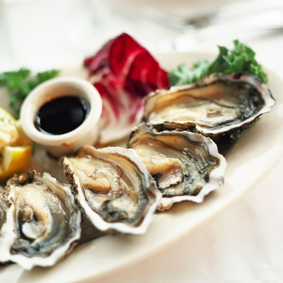 Dine on fresh oysters at restaurants close to Boston's TD Northbank Garden.