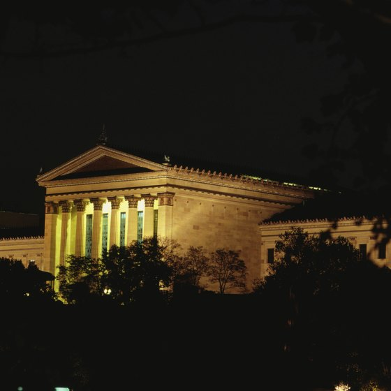 The Philadelphia Museum of Art, shown illuminated, is near the Schuylkill River.