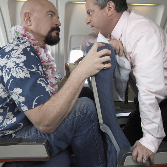 Consideration for neighbors can defuse tensions during a long middle-seat flight.