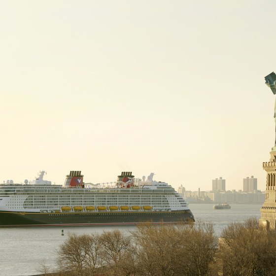 The 'Disney Fantasy' sails past the Statue of Liberty.