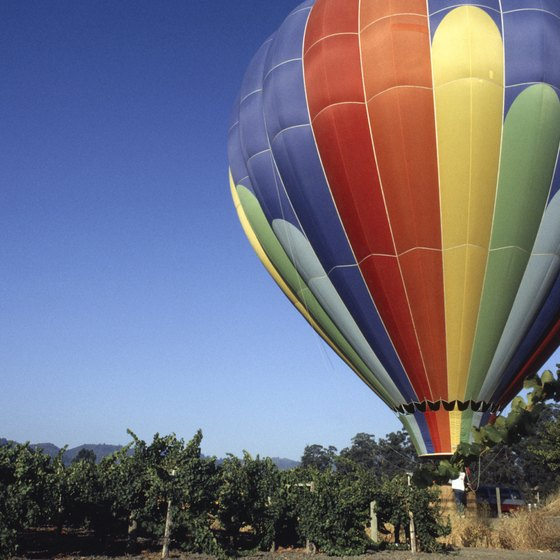 Hot air balloon near vineyards in Napa Valley.