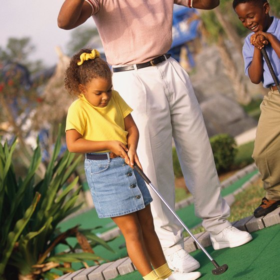 Play a round of mini-golf near Lake Worth.