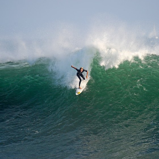 "Ride a huge wave at ""The Wedge,"" in Newport Beach."