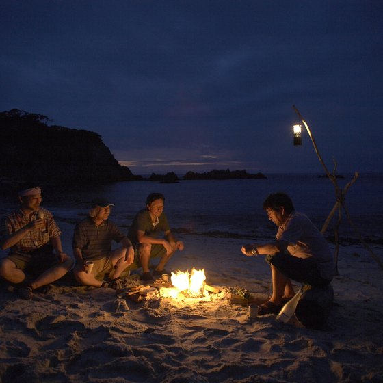 A beach bonfire provides a perfect ending to a day at the beach.
