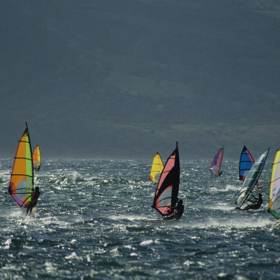 Windsurfing is popular at Kahana Beach Park and in Paia, Maui.
