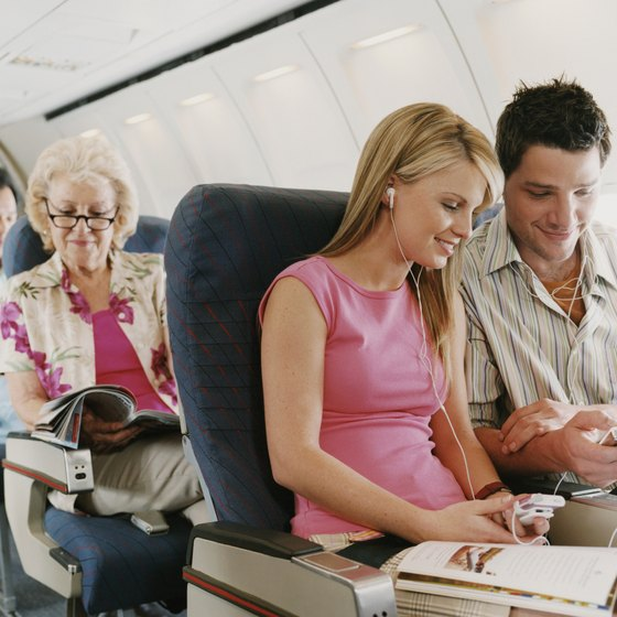 Minimize boredom on long flights by packing entertaining items and snacks.