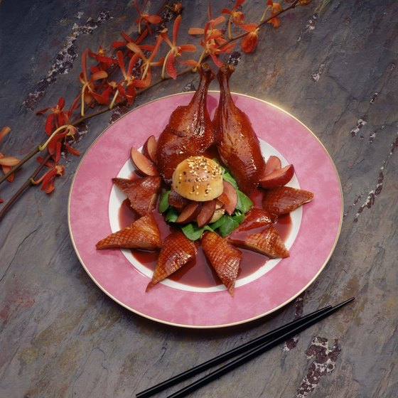 Head to New York City's Mott Street to dine on Peking duck.