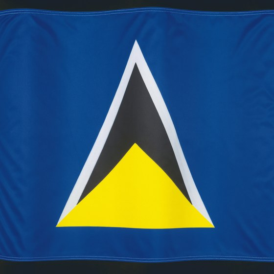 The triangles on St. Lucia's flag represent the Pitons.