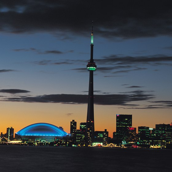 Enjoy the magnificent view of Toronto from the CN Tower in the evening.