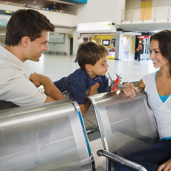 If your children are flying without you, accompany them through the airport to their gate.
