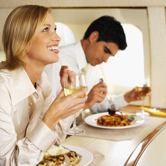 Wine is typically free on Transatlantic flights, but it will dehydrate you and worsen your jet-lag.
