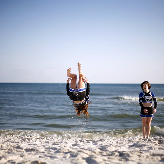 Visitors enjoy back flips on Pensacola Beach.