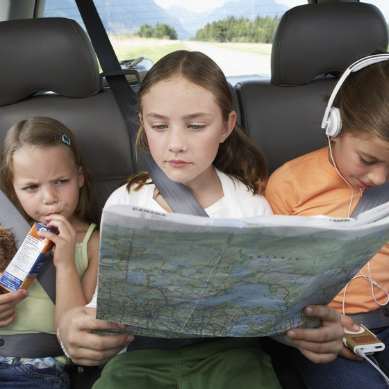 Keeping your children busy is the key to avoid problems during a long road trip.