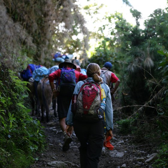 Many tourists hike the Inca Trail to Machu Picchu.