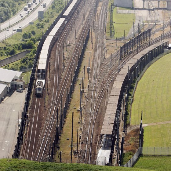Trains enter the Chunnel, which connects France and England.