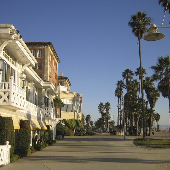 A wide boardwalk separates the sand from shops and restaurants at Venice Beach, California.
