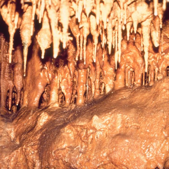While spelunking in Michigan, you can see stalagmites, stalactites and pictographs.