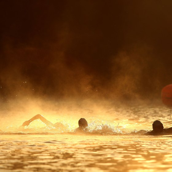 Athletes swim in the Russian River during a triathlon.