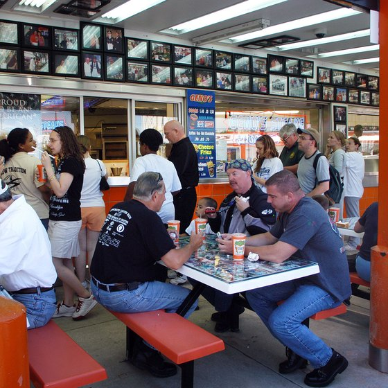 Many cheesesteak shops in Philadelphia -- such as Geno's Steaks -- have walk-up windows for ordering and covered sidewalk areas for eating.