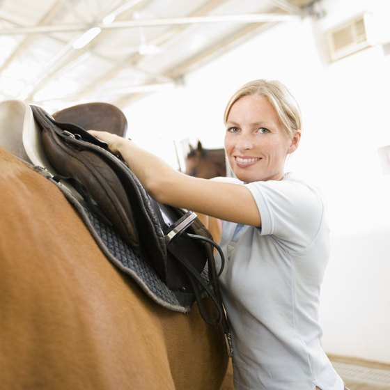 Horse owners must pay a monthly boarding fee to keep their animals at a stable.