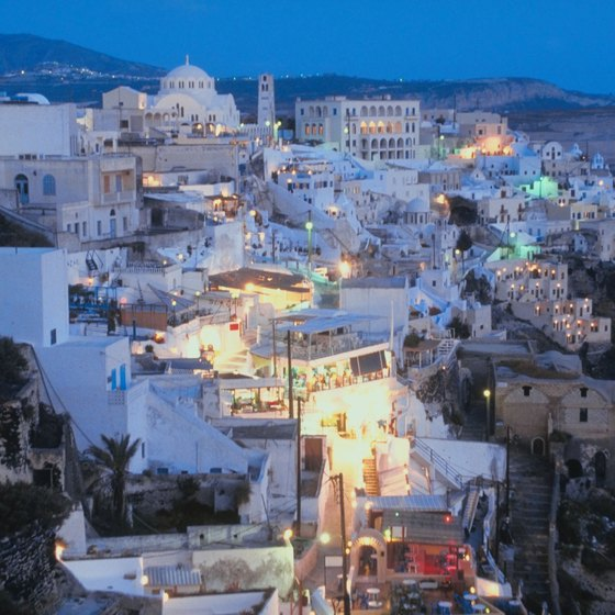 Santorini beckons travelers with its dramatic twilight cityscape.