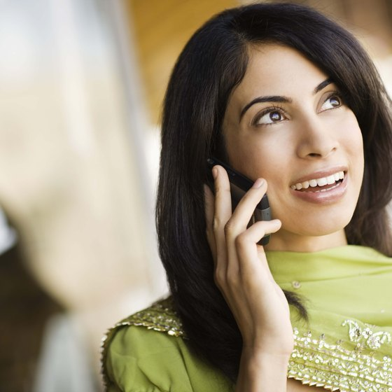 Many travelers use cell phones to call hotels or book restaurant reservations.