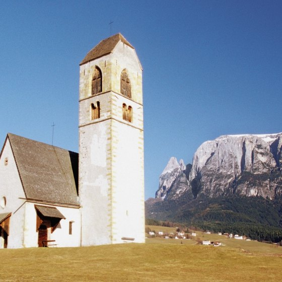 Medieval churches and castles dot the mountain towns of the Dolomites.