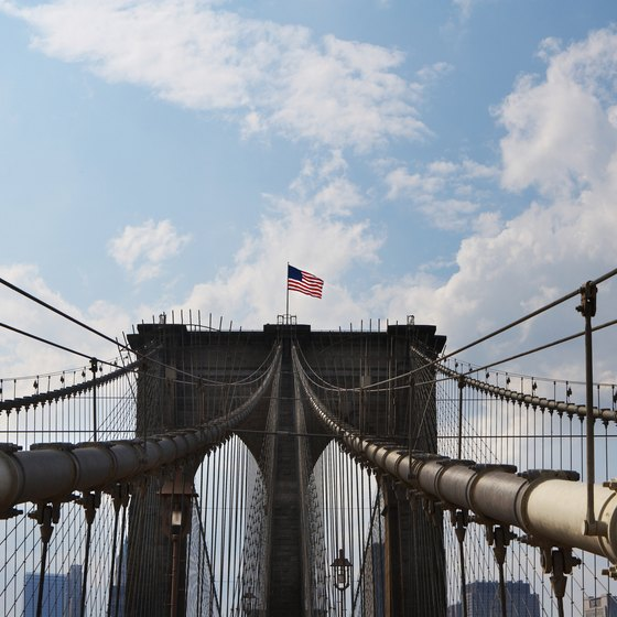 A romantic stroll across the Brooklyn Bridge offers impressive views of New York City.