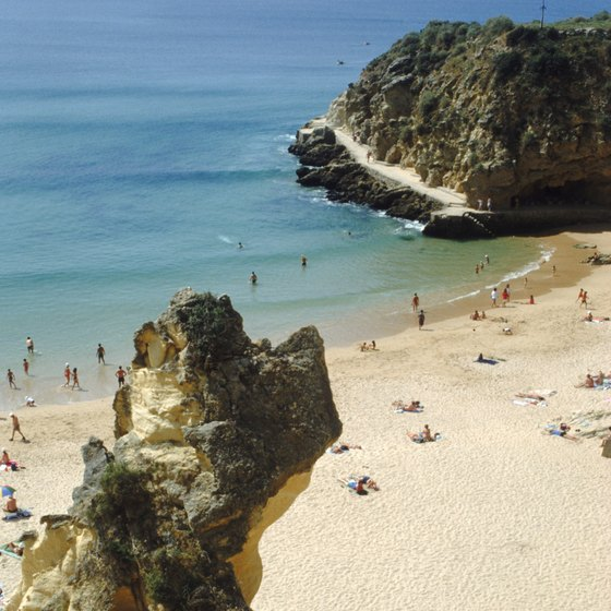 Looming cliffs and smooth sands characterize Portugal's Algarve coastline.