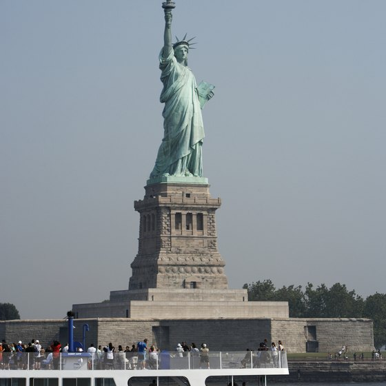 New York cruises travel past the Statue of Liberty.