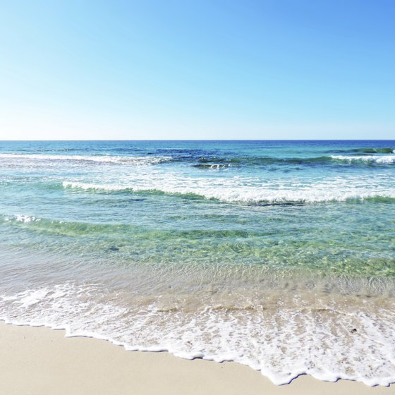 White sand and azure water greet you at the end of a road trip to Destin.