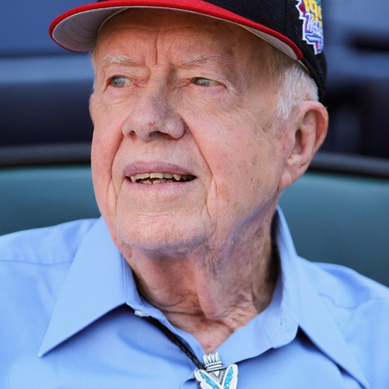 Former President Jimmy Carter sports an Atlanta Braves' baseball cap.